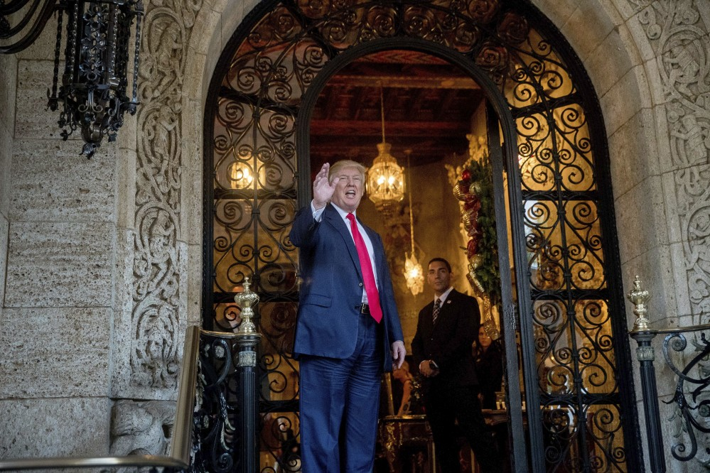 President-elect Donald Trump waves to members of the media after a meeting with admirals and generals from the Pentagon at Mar-a-Lago, in Palm Beach, Fla., last week.