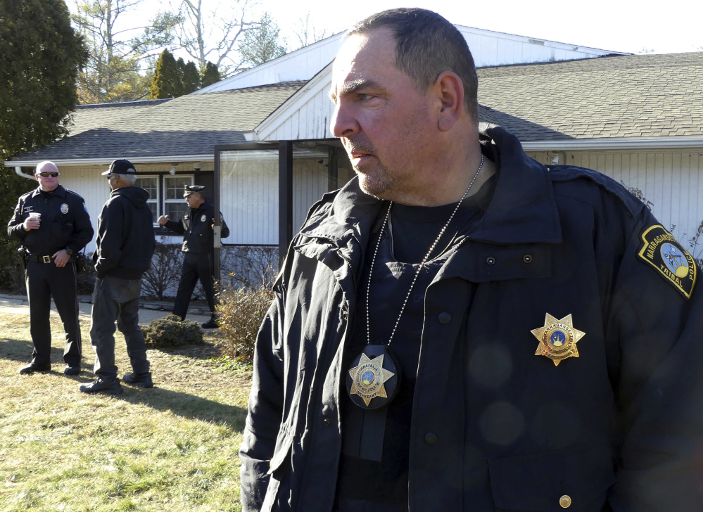 Tribal Police Sgt. Ed McQuaide stands outside the Narragansett tribe's administration building, in Charlestown, R.I., after a faction of the tribe took it over last Tuesday.