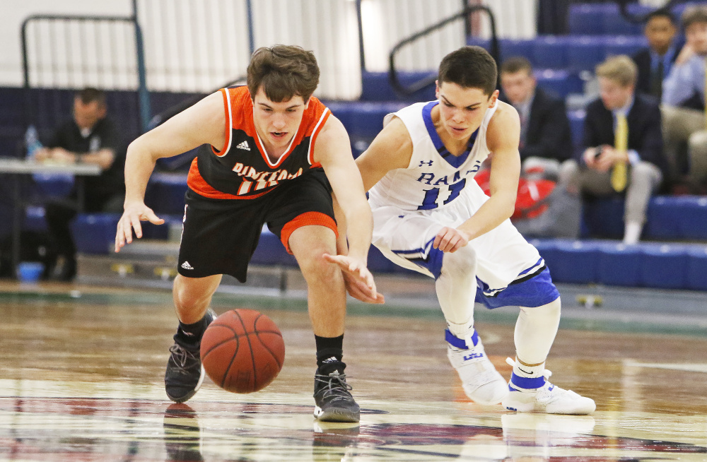 Carter Edgerton of Biddeford, left, and Tripp Bush of Kennebunk chase after a loose ball Tuesday during the first half of their SMAA game at the Portland Expo. Biddeford came away with a 76-46 victory.