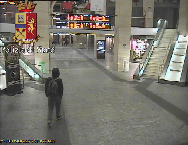 In this image from video made available by Italian police, Anis Amri, the suspected truck driver in Berlin's deadly Christmas market attack, walks through the Milan train station Dec. 22.