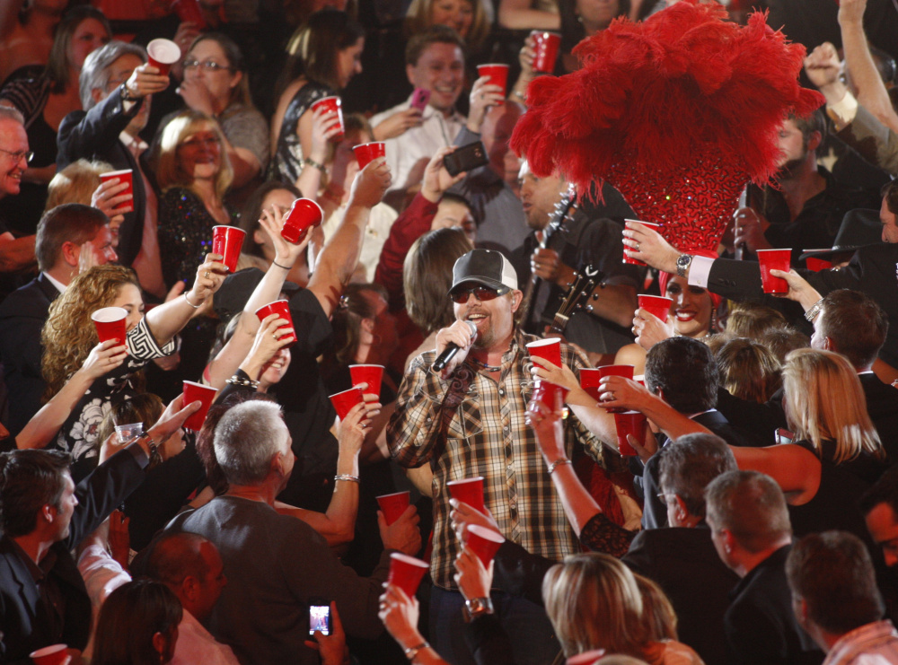 """Toby Keith performs """"Red Solo Cup"""" amid the audience at the 47th annual Academy of Country Music Awards in Las Vegas in 2012."""