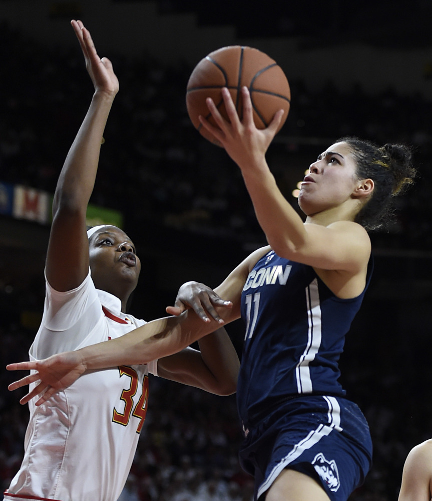 Kia Nurse of Connecticut heads to the basket Thursday night against Brianna Fraser of Maryland during the second half of Connecticut's 87-81 victory.