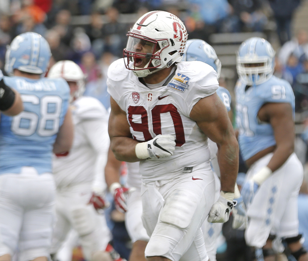 Stanford's Solomon Thomas celebrates after sacking North Carolina quarterback Mitch Trubisky on a 2-point conversion attempt that would have tied the Sun Bowl.