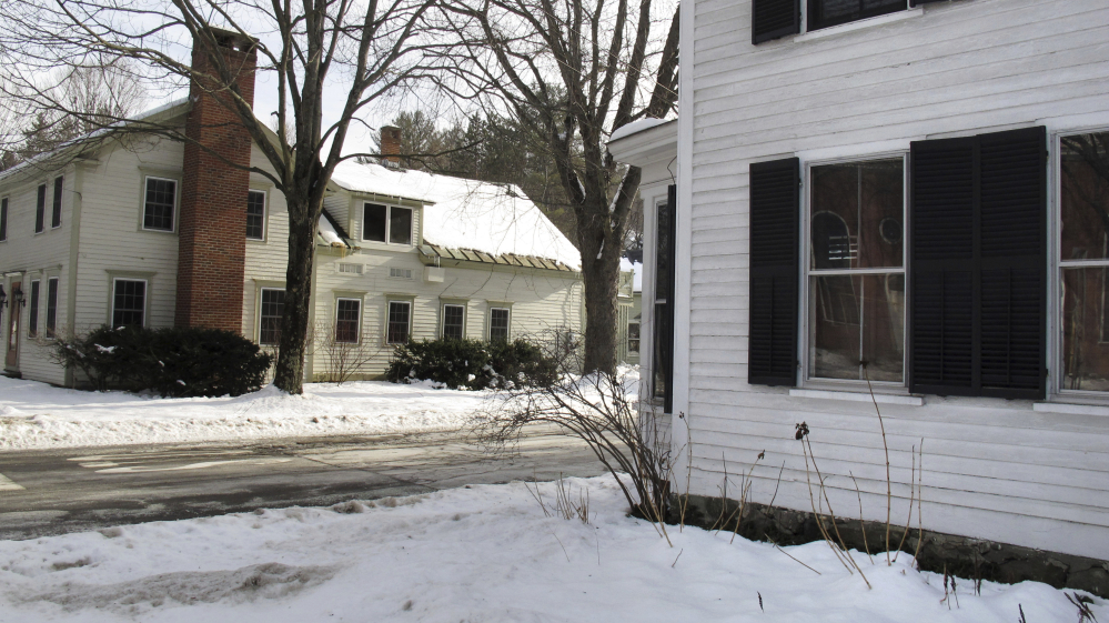 A home with shutters and another without are emblematic of the conflict in Woodstock, Vt., known for its historic New England charm. Some residents dispute a requirement that most buildings in the central distric have shutters.