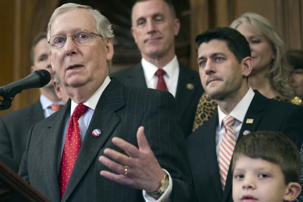 House Speaker Paul Ryan of Wisconsin and others listen as Senate Majority Leader Mitch McConnell of Kentucky speaks on Capitol Hill in Washington.