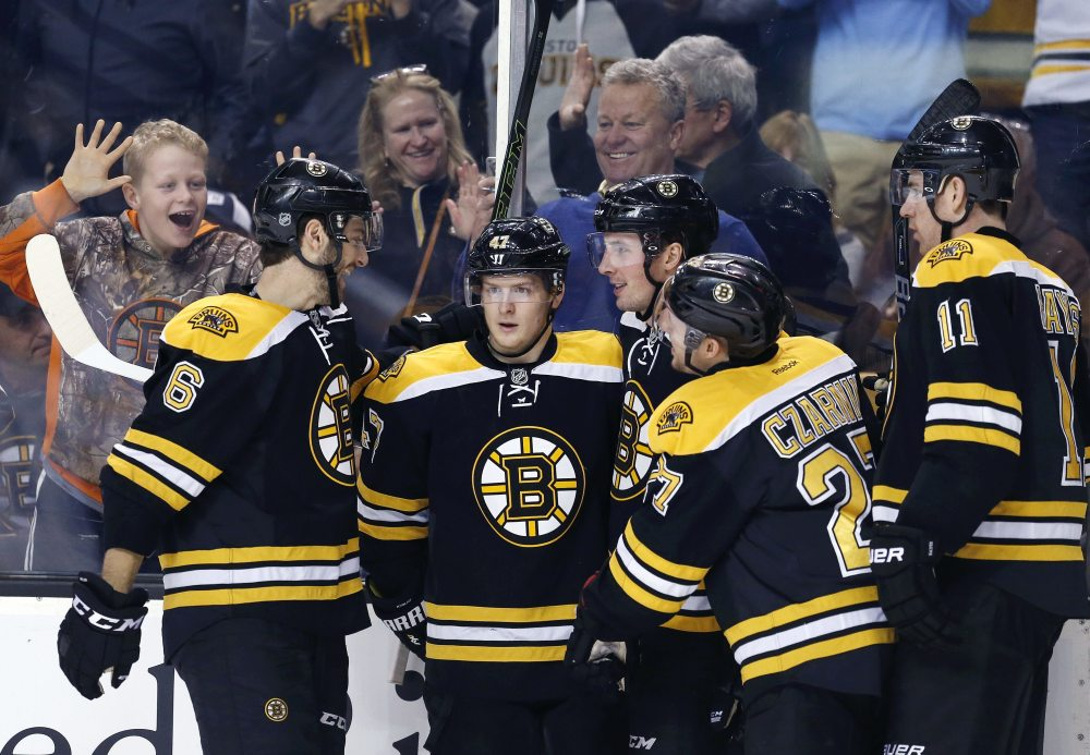 Boston's Tim Schaller, third from right, celebrates his goal with teammates Colin Miller (6), Torey Krug (47), Austin Czarnik (27) and Jimmy Hayes (11) during the second period Saturday's game against Buffalo in Boston. (Associated Press/Michael Dwyer)