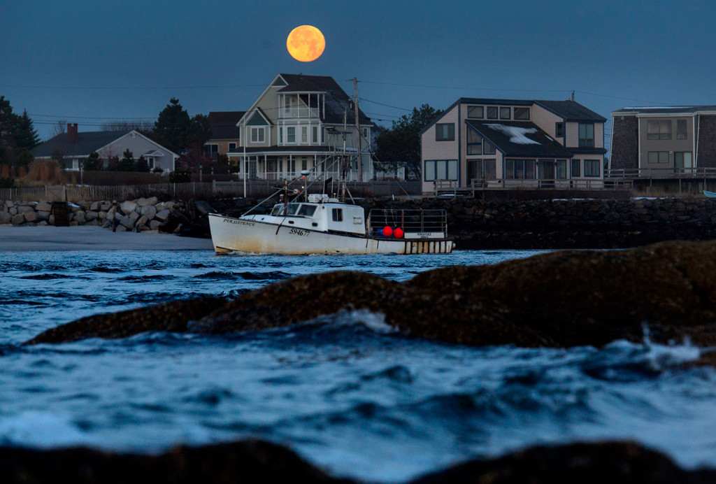 The fishing vessel Persistence leaves the Scarborough River as it heads past Pine Point in Scarborough under a full moon on Wednesday morning.