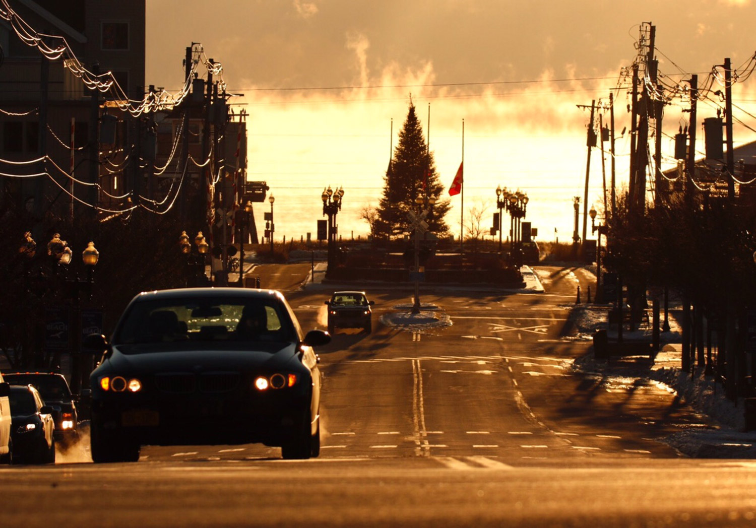 As sea smoke blankets the Atlantic in the background, commuters make their way along Old Orchard Street Friday in sub-zero temperatures.