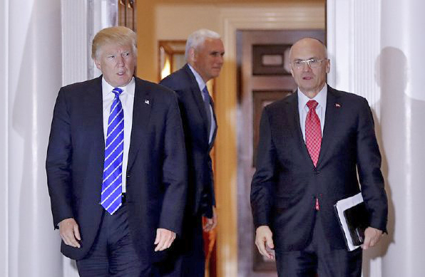 Andy Puzder, right, chief executive of CKE Restaurants, is reported to  be Trump's nominee for secretary of labor. <em>Associated Press/Carolyn Kaster</em>