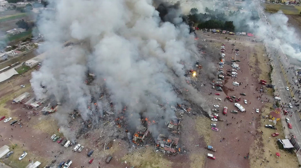 This image made from video shows a view from a drone of smoke billowing from the San Pablito Market, where an explosion ripped through a fireworks market Tuesday. Pro Tultepec via APTN