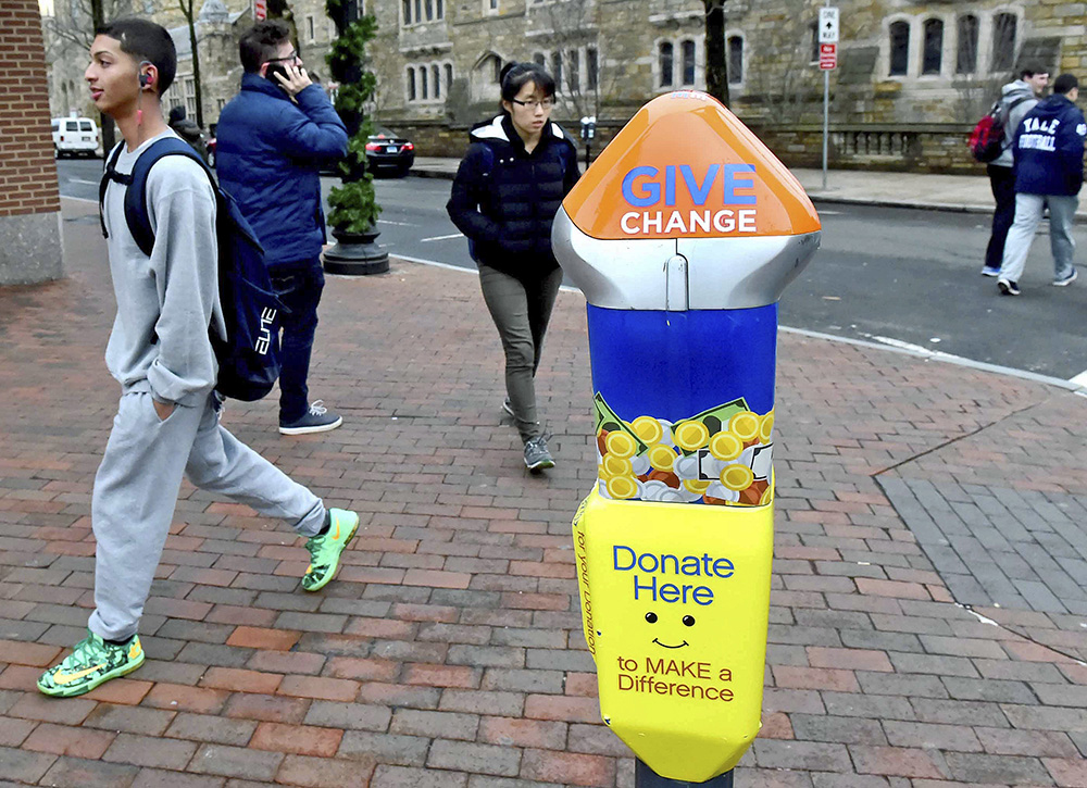 One of four parking-style meters in New Haven, Conn., that are located in areas where panhandling has been prevalent. There are plans to install six more to support local, nonprofit organizations that help the homeless. <em>Peter Hvizdak /New Haven Register via AP</em>