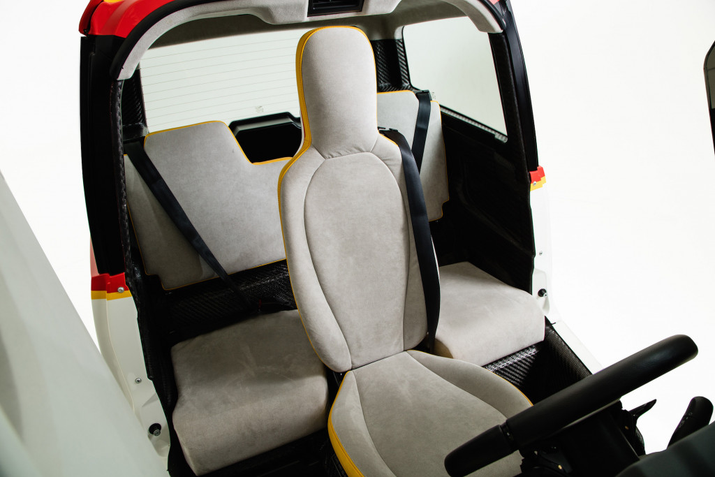 The driver's seat, like a Formula One race car's, is mounted in the center of the vehicle.
