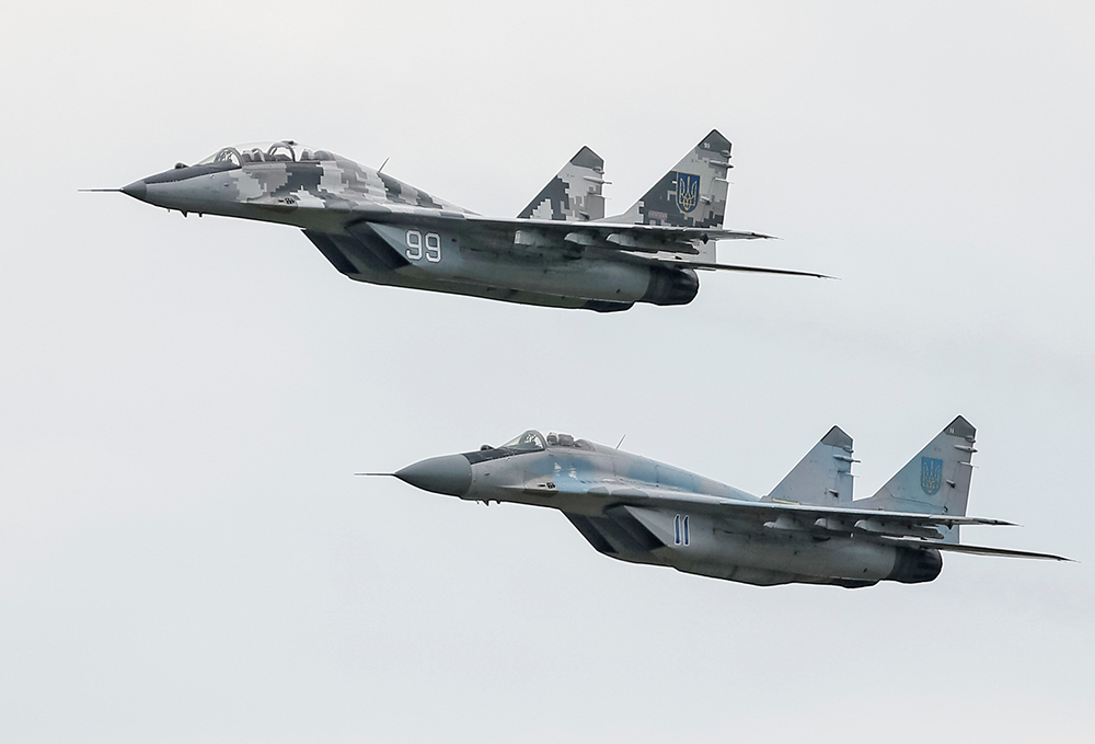 MIG-29 fighter planes fly at a military air base in Vasylkiv, Ukraine, on Aug. 3, 2016. <em>Reuters/Gleb Garanich</em>