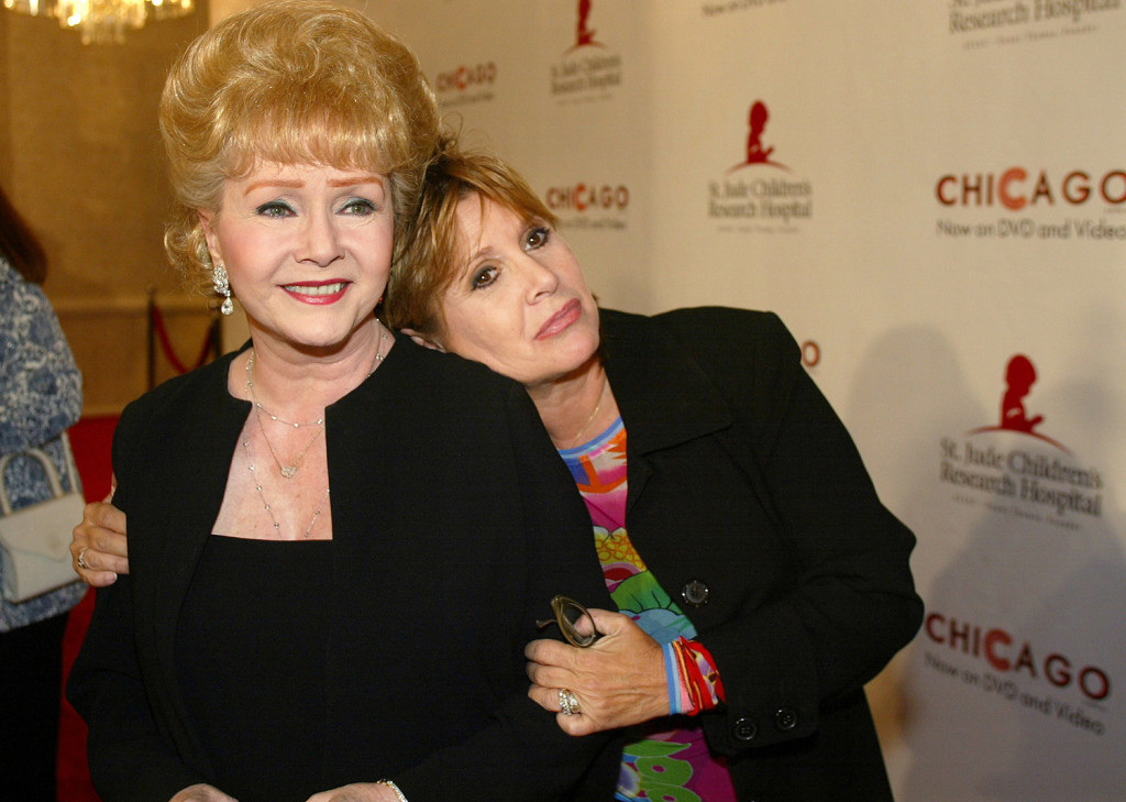 Debbie Reynolds gets a hug from her daughter Carrie Fisher at a charity event in Beverly Hills, Calif., in 2003. When Reynolds passed away this week, her son said the stress of Fisher's death the day before was too much for his mother to take.