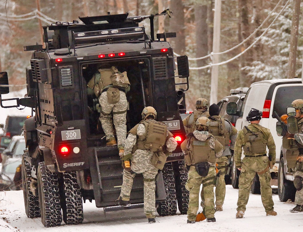 The Cumberland County sheriff's SWAT unit prepares to move closer to the scene of a  standoff on Smith Mill Road in Standish Thursday morning. <em>Carl D. Walsh/Staff Photographer</em>