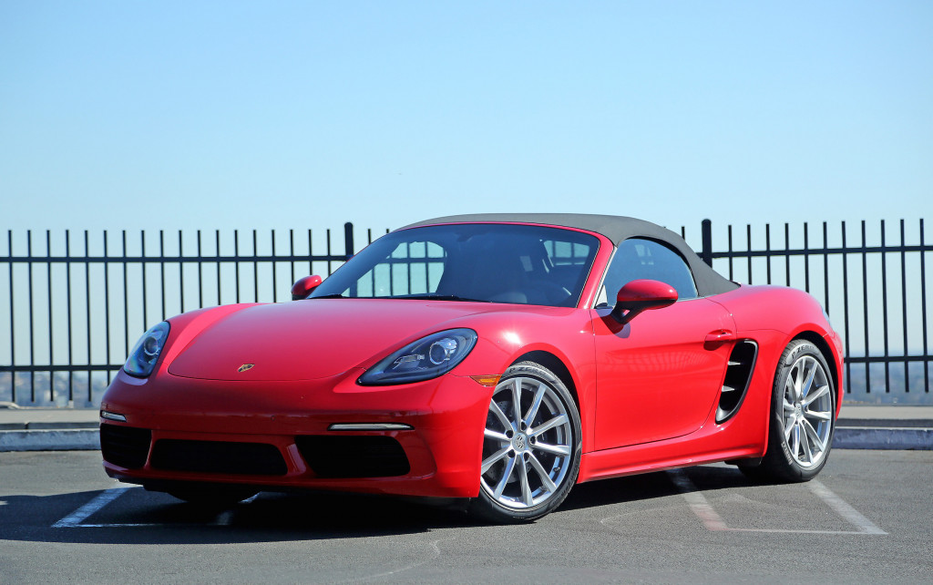 The 2017 Porsche 718 Boxster with the top up. The newest Boxster comes with a 2.0-liter, turbocharged boxer four cylinder engine that makes 300 horsepower. A six-speed manual transmission puts the power to the ground.