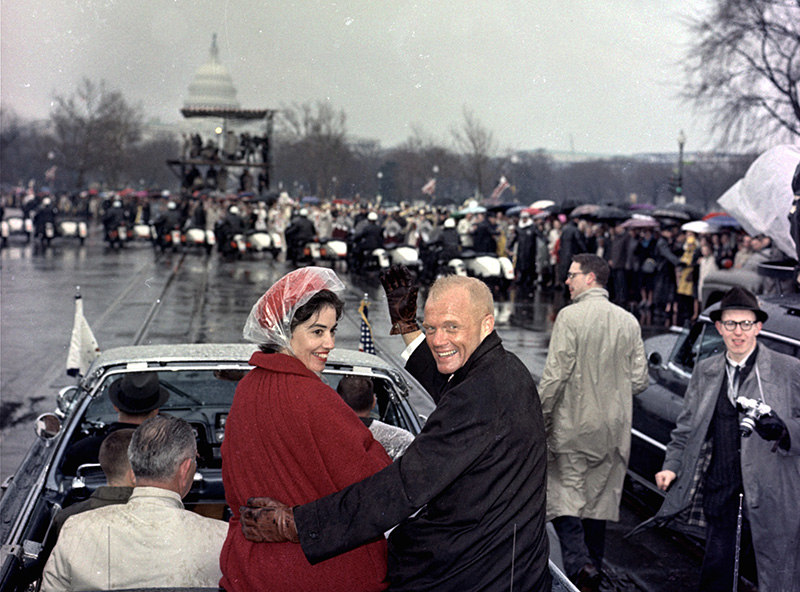 Mercury astronaut John Glenn, and his wife, Annie, ride in the back of an open car with Vice-President Johnson during a parade in Glenn's honor in Washington in February 1962.