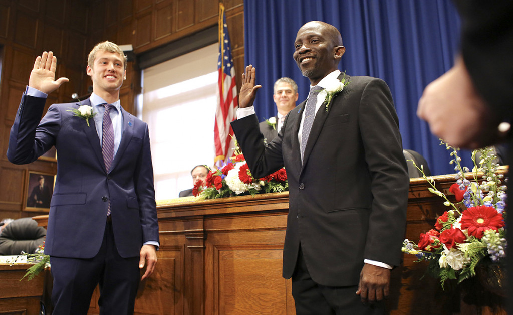 Newly elected Portland City Councilors Brian Battson, left, and Pious Ali are sworn in Monday at City Hall. <em>Ben McCanna/Staff Photographer</em>