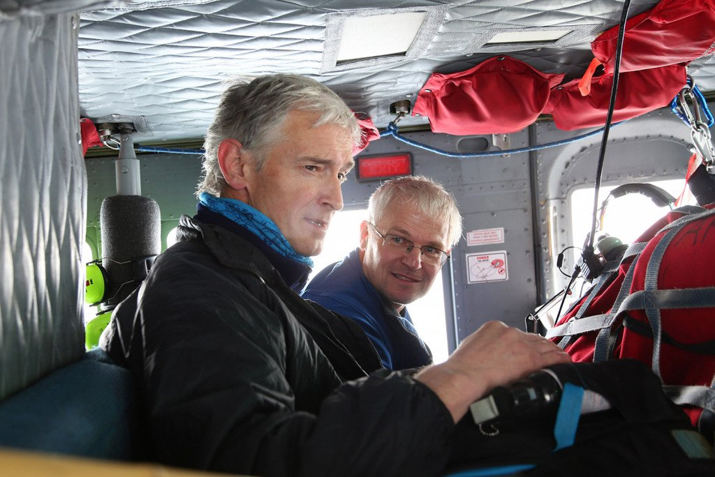 Keith Nicholls, left, and Andreas Muenchow look out of the helicopter to check the condition of equipment they had installed a year earlier.