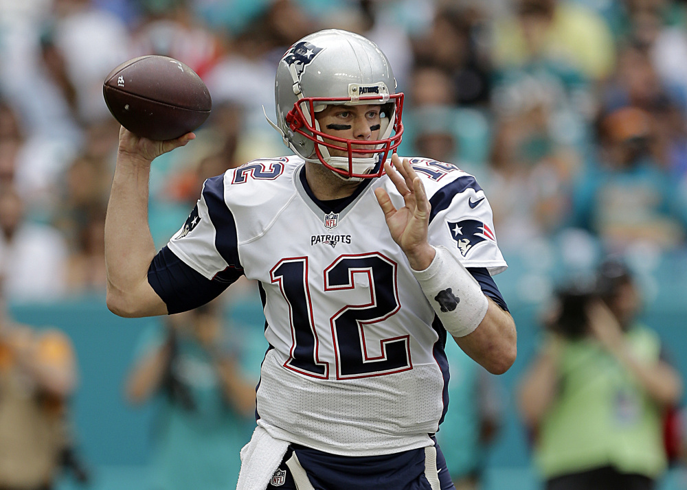 New England Patriots quarterback Tom Brady looks to pass during the first half against the Dolphins on Sunday in Miami Gardens, Fla.