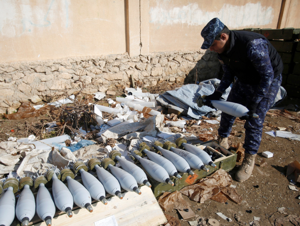 An Iraqi security forces member inspects ammunition Sunday during a battle with Islamic State militants in Mosul.