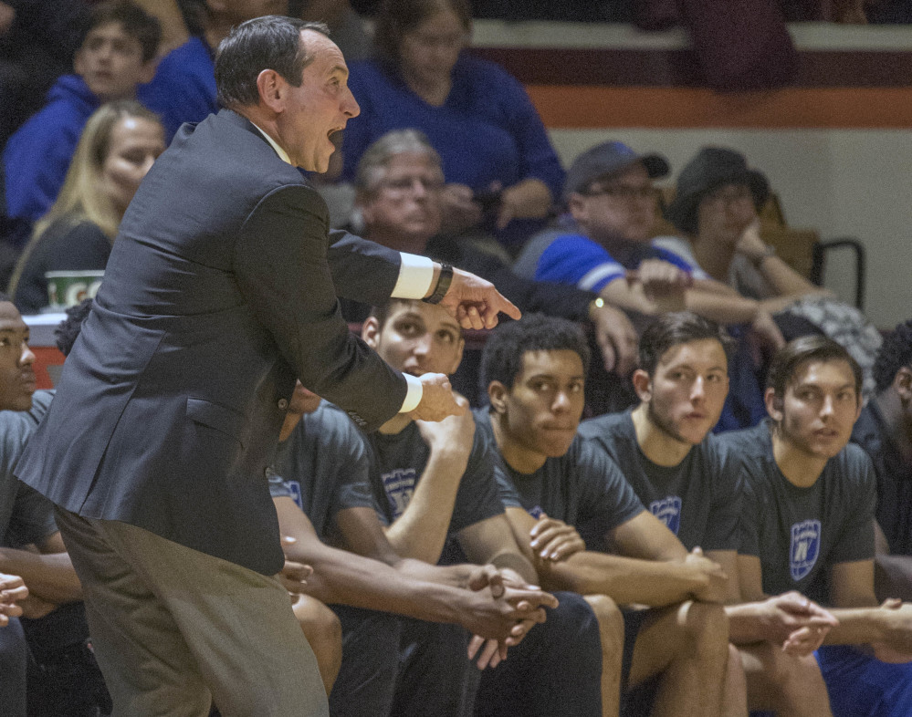 Duke head coach Mike Krzyzewski yells to his players during the first half of an NCAA college basketball game Saturday, Dec 31, 2016, at Cassell Coliseum in Blacksburg, Va. Tech won 89-75. (AP Photo/Don Petersen)