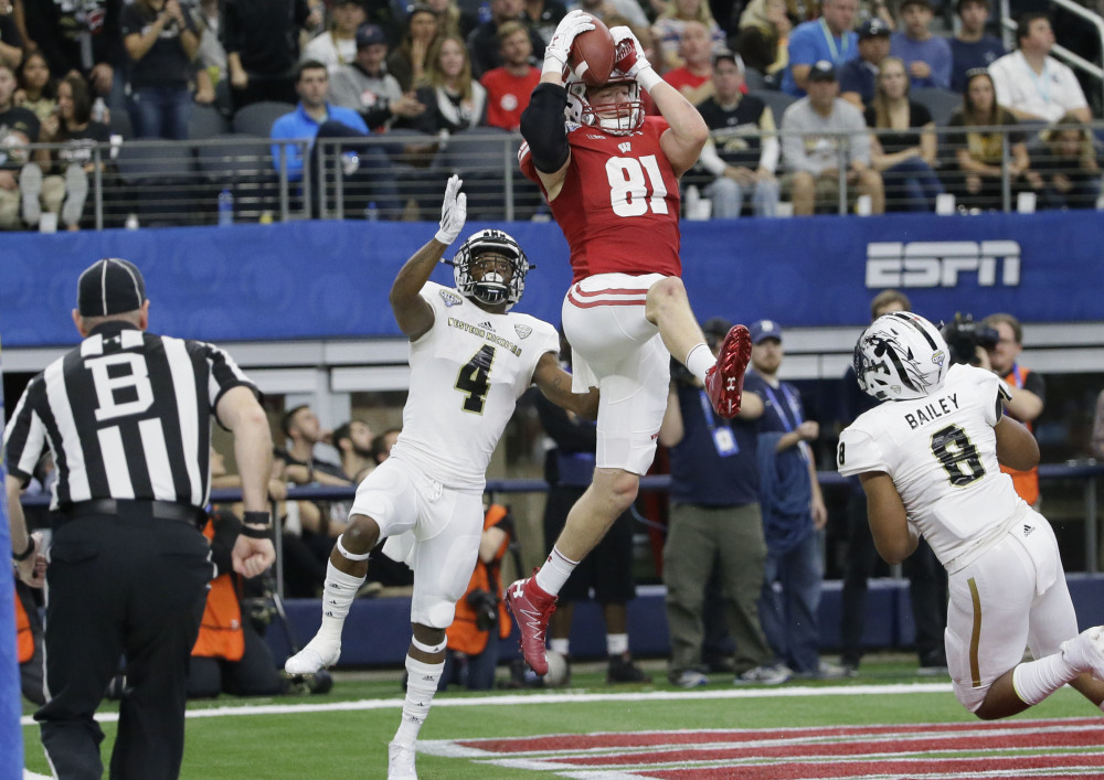 Wisconsin tight end Troy Fumagalli catches a touchdown pass between Western Michigan defenders Darius Phillips, left, and Caleb Bailey during the fourth quarter of Wisconsin's 24-16 Cotton Bowl win Monday at Arlington, Texas.