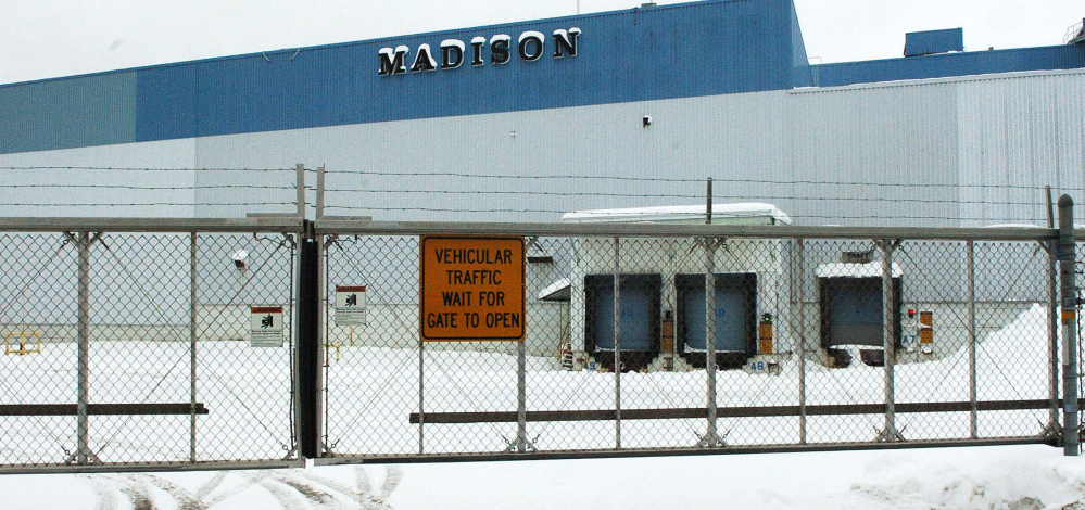 Gates are closed and locked Tuesday at the closed former Madison Paper Industries mill, where new owners hope to redevelop a portion of the property.