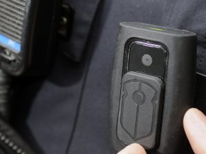 Body cameras are often attached to the lapel or chest area of police officers and record audio and video.
