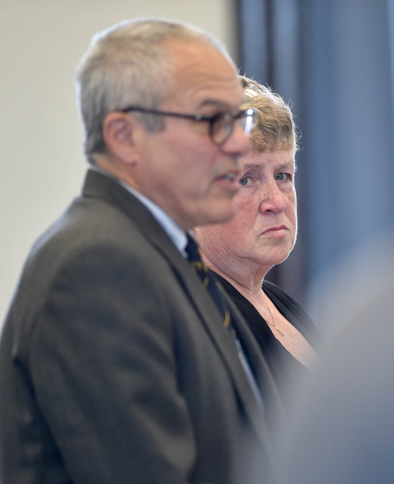 Julie Smith stands with her attorney, Woody Hanstein, in Somerset County Superior Court in Skowhegan in May, when she pleaded guilty to embezzling more than $90,000 from the Somerset County District Attorney's Office.