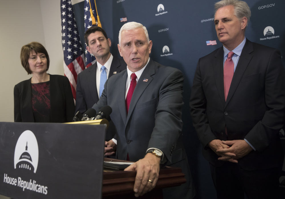 Vice President-elect Mike Pence, center, is joined by, from left, Rep. Cathy McMorris Rodgers, R-Wash., chair of the House Republican Conference, House Speaker Paul Ryan of Wisconsin, and House Majority Leader Kevin McCarthy of California, at a news conference following a closed-door meeting with the Republican caucus in Washington on Wednesday. Pence and Ryan promised repeal of President Obama's health care law.