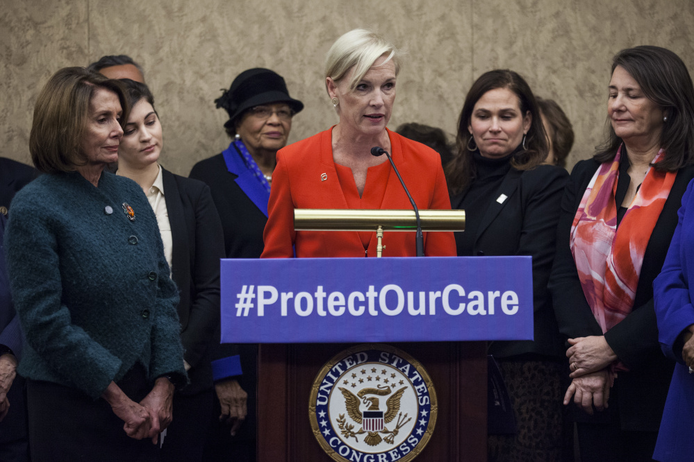 Planned Parenthood President Cecile Richards, center, House Minority Leader Nancy Pelosi, D-Calif., left, and Rep. Diana DeGette, D-Colo., right, discuss Republican efforts to defund the organization at a news conference Thursday in Washington.
