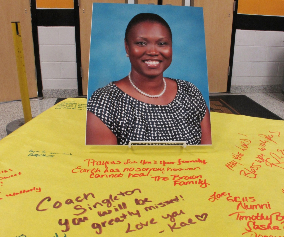 A picture of Sharonda Coleman-Singleton, a school speech pathologist and girls' track coach, sits on a large paper signed by students, teachers and friends in Goose Creek, S.C., in June 2015. She was one of the nine people killed by Dylan Roof at Emanuel AME Church.