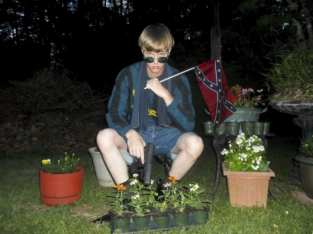 This undated photo that appeared on Lastrhodesian.com, a website investigated by the FBI in connection with Dylann Roof, shows him posing for a photo holding a Confederate flag. Roof faces life in prison or execution for gunning down nine black church members in a racially motivated attack in 2015.