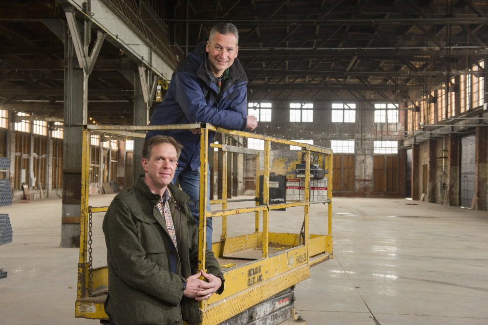 Chris Thompson, front, and his partner, Jed Troubh, are developing the 27,000-square-foot Brick South Event Center at Thompson's Point in Portland.