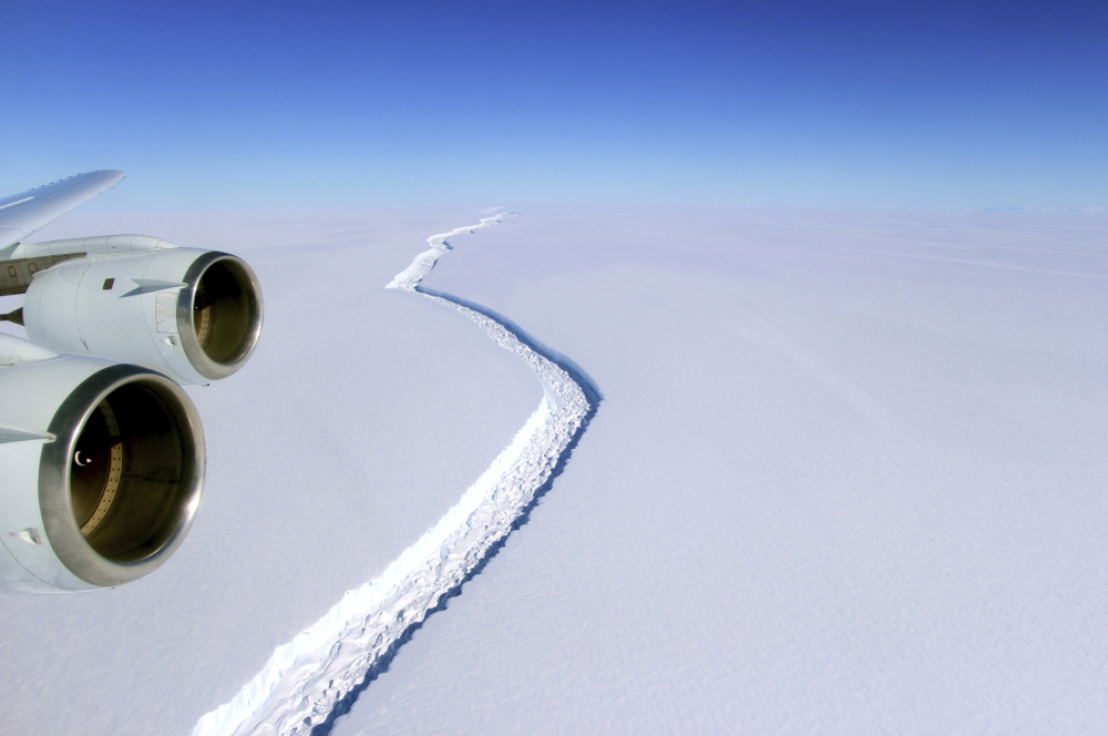 This aerial photo released by NASA shows a rift in the Antarctic Peninsula's Larsen C ice shelf. According to NASA, IceBridge scientists measured the fracture at 70 miles long.