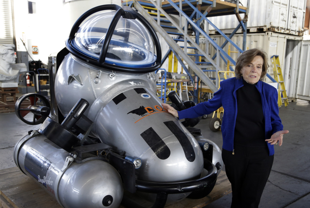 Sylvia Earle, former NOAA chief scientist and the founder of ocean advocacy group Mission Blue, shows off a full-size replica of the Deep Water 2000 submersible at Deep Ocean Exploration and Research Marine in Alameda, Calif., last month. She says aquaculture offers environmentally sustainable and economically viable options.