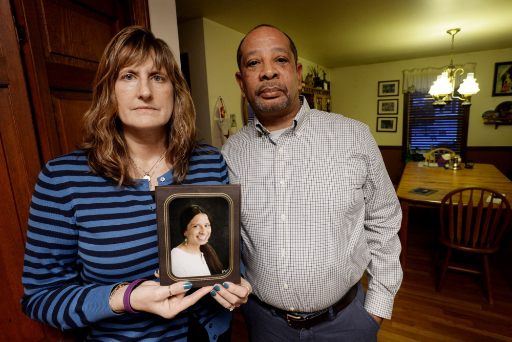 Judith and Wayne Richardson, the parents of Darien Richardson, whose killing in 2010 remains unsolved, hold a photograph of her in 2014.
