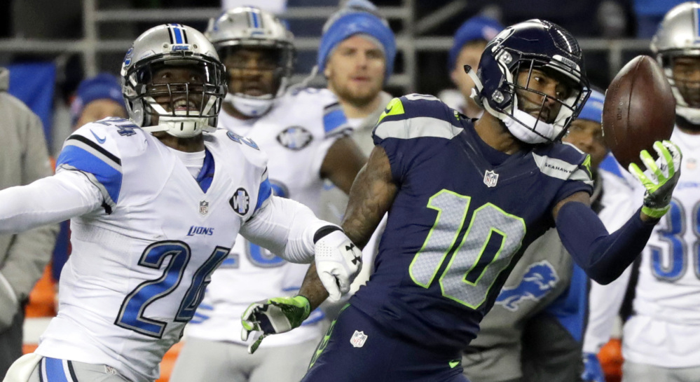 Paul Richardson makes a one-handed catch against Lions cornerback Nevin Lawson during Seattle's 26-6 win in an NFC playoff game Saturday night.