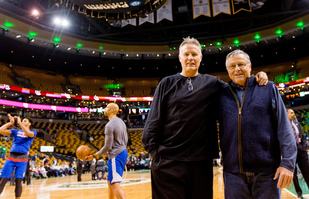 Bob Brown of Scarborough, right, and his son, Brett, get together before Friday's game between the Celtics and 76ers at TD Garden.