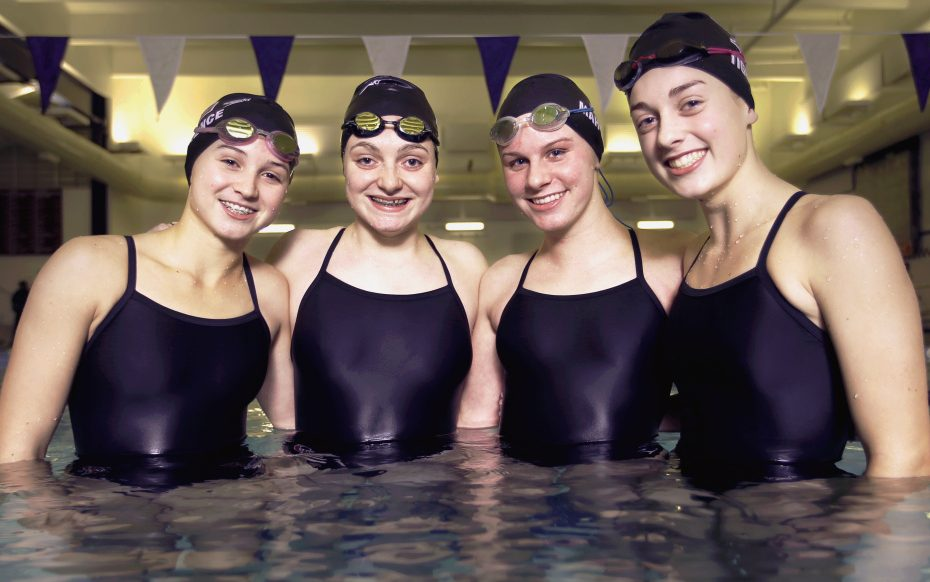 Four Cape Elizabeth swimmers set a school record in the 400-yard freestyle relay on Thursday. From left, Alicia Lawrence, Emily Ecker, Caroline Mahoney and Olivia Tighe turned in a time of 3:40.42. Ben McCanna/Staff Photographer