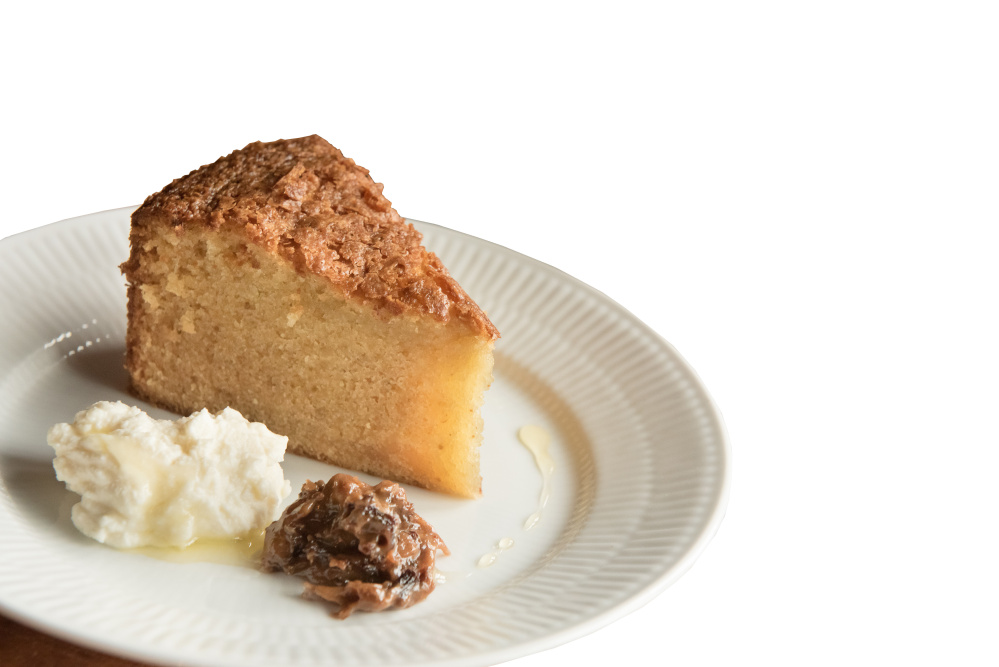Olive oil cake with prune jam and whipped ricotta