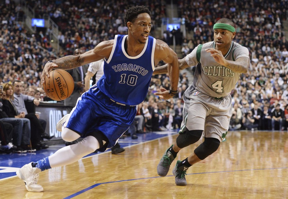 Toronto Raptors guard DeMar DeRozan, 10, drives past Boston Celtics guard Isaiah Thomas during the second half Tuesday in Toronto.