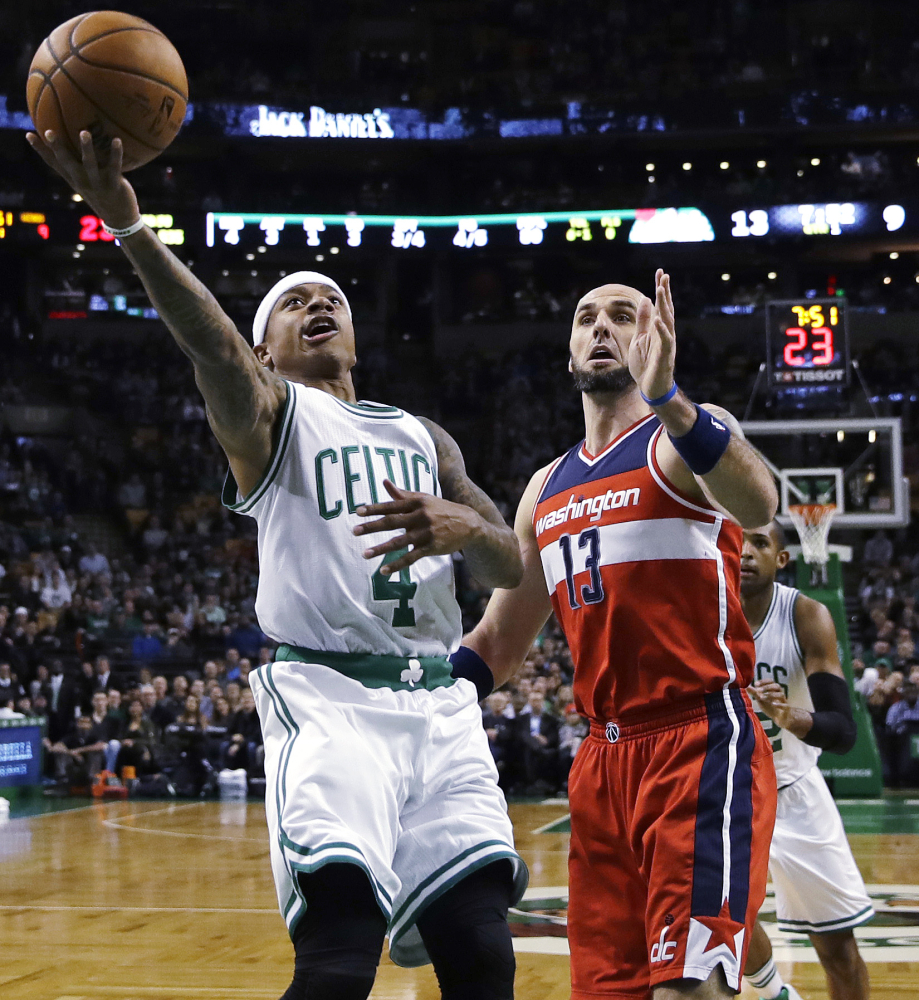 Celtics guard Isaiah Thomas drives to the basket past Washington center Marcin Gortat in the first quarter Wednesday night in Boston.