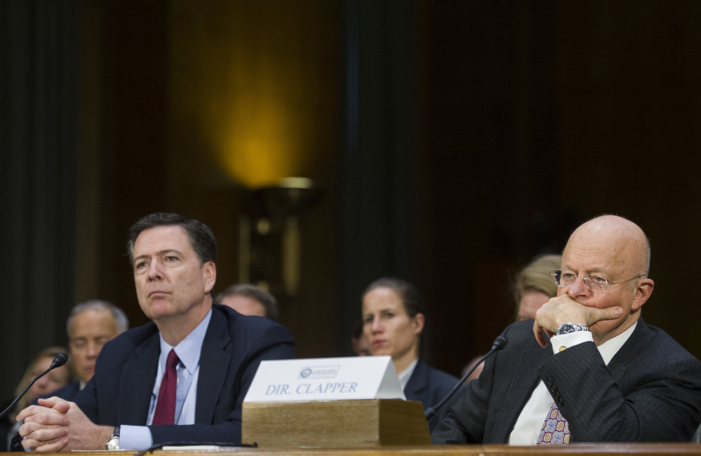 Associated Press/Cliff Owen FBI Director James Comey, left, and Director of National Intelligence James Clapper appear on Capitol Hill in Washington on Tuesday before the Senate Intelligence Committee hearing on Russian intelligence activities.