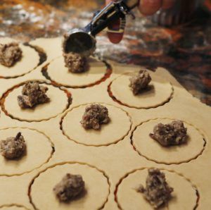 Christine Burns Rudalevige adds mushroom and fresh cheese filling to rounds of turnover dough (made with local cream cheese).