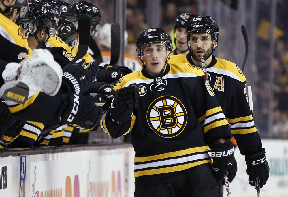 Boston's Brad Marchand celebrates his first-period goal during Saturday's 6-3 win over the Philadelphia Flyers in Boston Marchand finished with two goals and three assists. (Associated Press/Michael Dwyer)