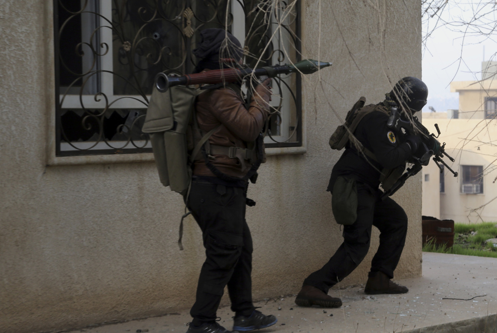 Special forces fight against Islamic State militants to regain control of Mosul University, in the eastern side of Mosul, Iraq, on Saturday. Regaining western Mosul could prove a more difficult task, as it's home to many government buildings and densely packed with civilians.