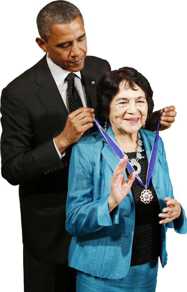 "President Obama awards Dolores Huerta, co-founder of the United Farm Workers, the Presidential Medal of Freedom in 2012. Her group coined the ""Yes we can"" slogan – in Spanish."