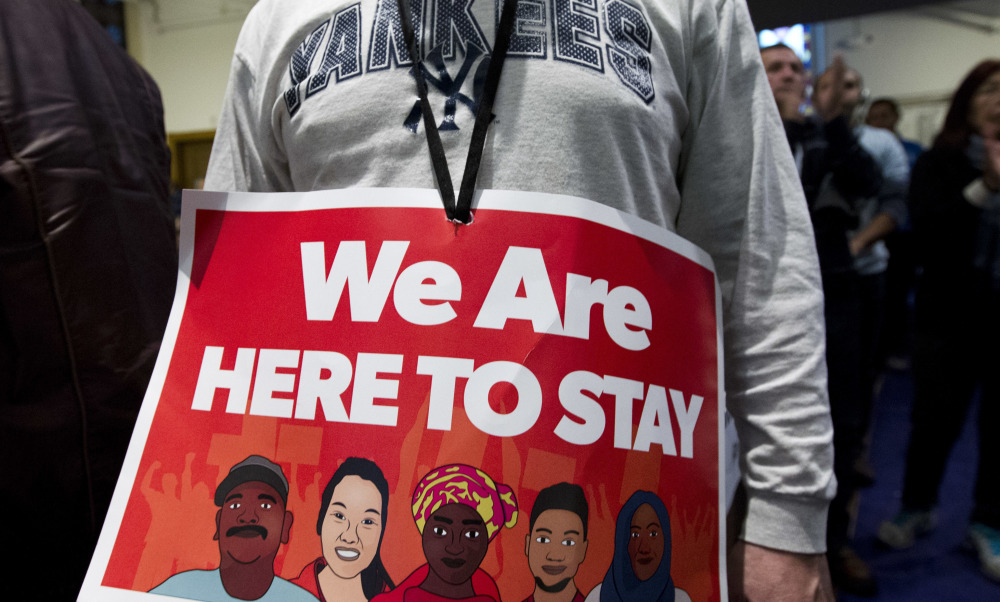 Immigrant rights advocates demonstrate during a rally at Metropolitan AME Church in Washington on Saturday.
